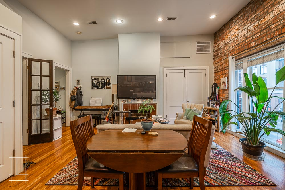 A dining room with exposed brick, open concept, high ceilings, and hardwood floors makes for a great space. Located in Columbus, Ohio, Lykens Companies serves Columbus, Ohio's urban core with an eye toward historical preservation and restoration. We are deeply involved in the Short North, Victorian Village, Italian Village, Olde Towne East, and Weiland Park communities. We are a landlord, property management, and property development company. We create the best Short North apartments and rentals: Short North Apartment Rentals and Apartments, Wonder Bread, houses for rent in Columbus, Ohio, Downtown apartments and Downtown Columbus rentals and apartments. For rent!